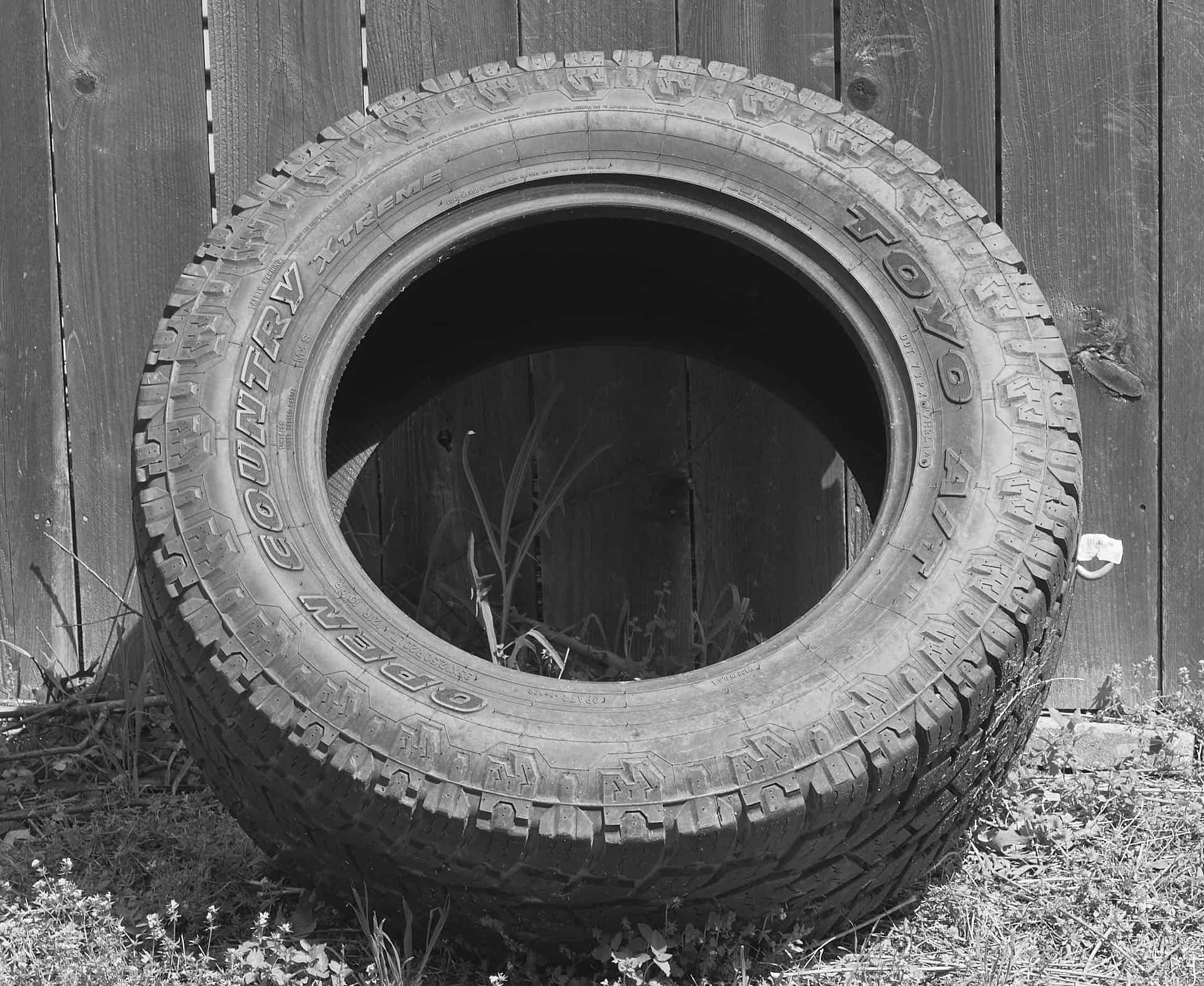 Image of a new tire in an alley with a new bolt inserted