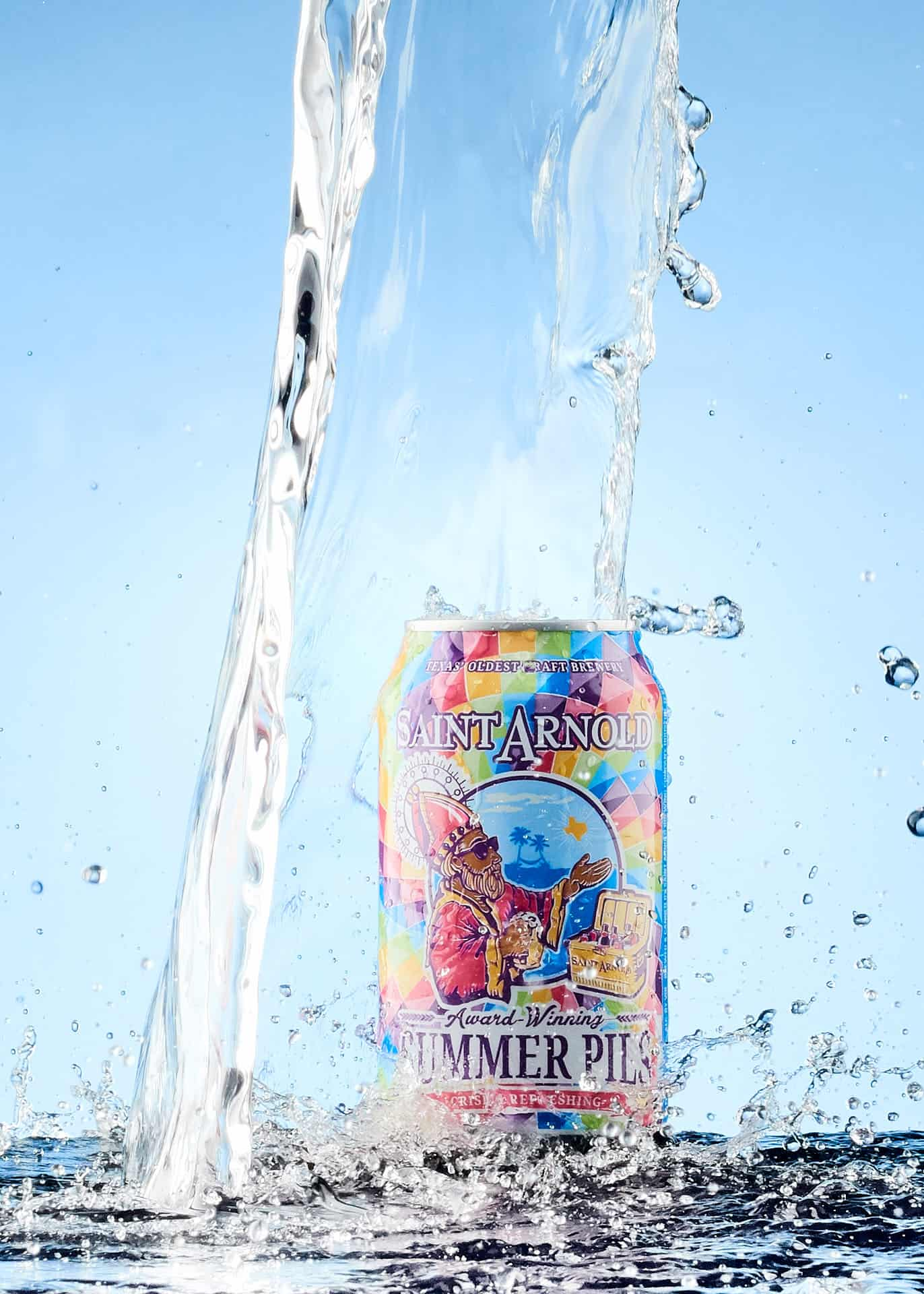 Saint Arnold Beer splashed with water.
