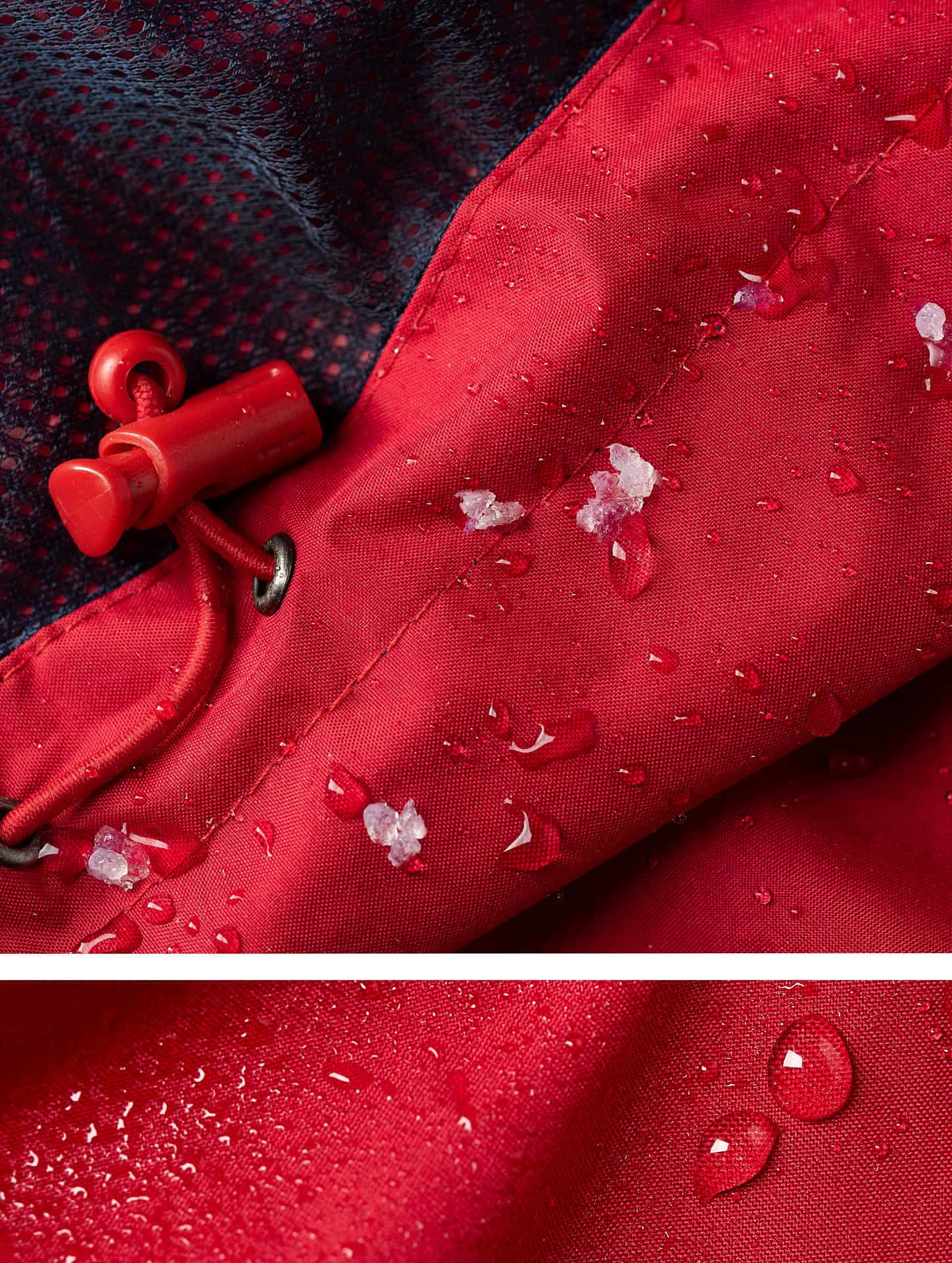 Sleet and rain on a red waterproof jacket with a blue inner liner.