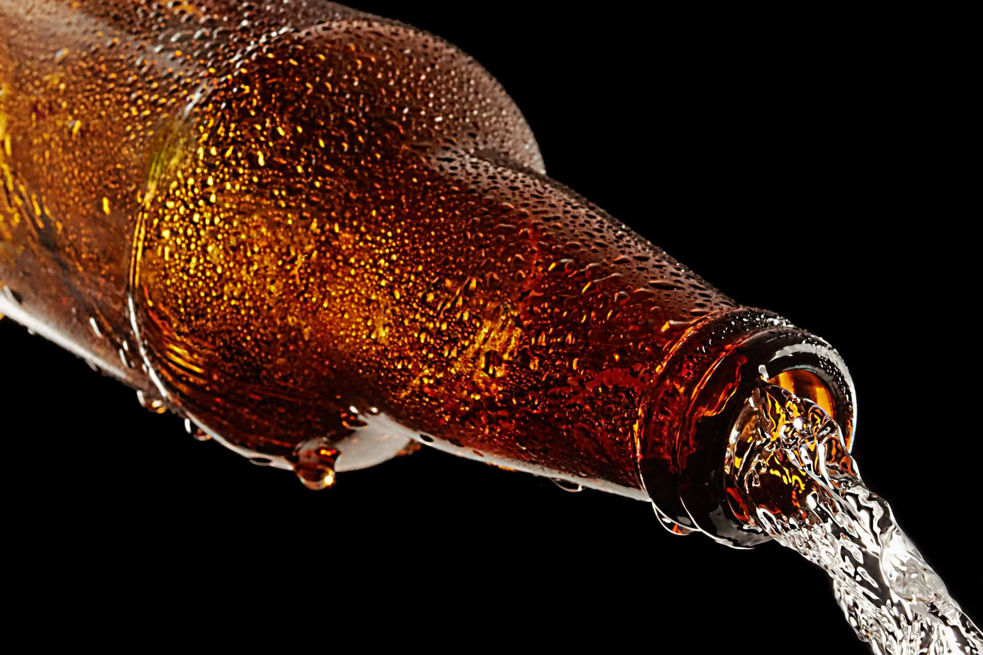 Closeup of a frosted beer pour.